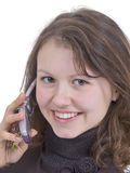 Mobile conversation. Pretty girl talk by mobile phone and smile Stock Photo