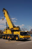 Mobile Crane. Side view of parked, yellow mobile crane stock images
