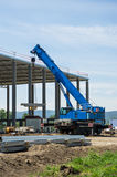 Mobile crane. Large construction site with blue mobile crane Stock Images
