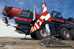 Mobile crane. A huge powerful mobile crane and its support stud, ready for action Royalty Free Stock Photography