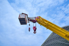 Mobile crane. On the blue sky Royalty Free Stock Images