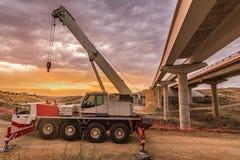 Mobile crane building a highway bridge stock image