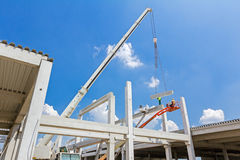 Mobile crane is carry concrete joist to assembly huge hall. Stock Image