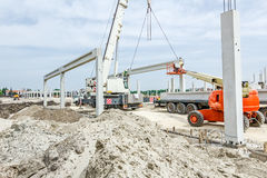 Mobile crane is carry concrete joist to assembly huge hall Stock Images