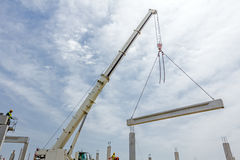 Mobile crane is carry concrete joist to assembly huge hall Royalty Free Stock Photos