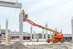 Mobile crane is carry concrete joist to assembly huge hall Stock Image