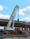 Mobile crane on the construction of the motorway Stock Images