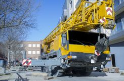 Mobile crane at construction site royalty free stock image