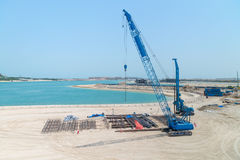 Mobile Crane Doing Construction Work on a Sandy Beach Royalty Free Stock Image