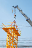 Mobile crane lifting a structure Stock Photo