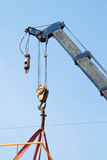 Mobile crane lifting a structure Stock Images