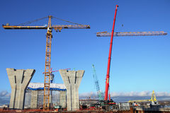 Mobile crane lifts up a section of the tower crane. Royalty Free Stock Photo