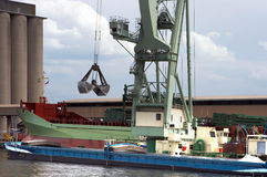 Mobile crane loading a ship Stock Images