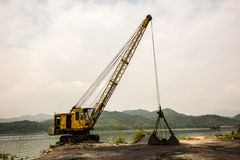 Mobile crane. Crane with magnet in junk yard Royalty Free Stock Images