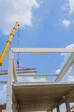 Mobile crane is operating and lifting concrete joist. Mobile crane is carry concrete joist to assembly huge hall Royalty Free Stock Images