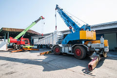 Mobile crane operating by lifting and moving an heavy Royalty Free Stock Photo