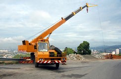 Mobile crane in operation2. Yellow mobile crane operator in operation Royalty Free Stock Images