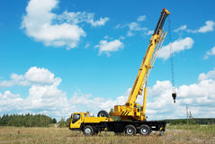 Mobile crane with rised boom stock photos