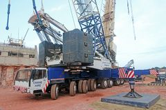 Mobile crane. On a road construction site Stock Images