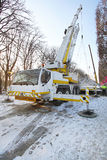 Mobile crane truck. Lifting structure at construction site Stock Photo