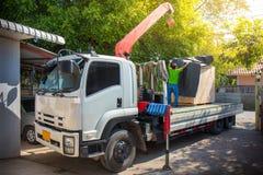 Mobile crane is unloading reinforcing mesh from truck trailer stock image