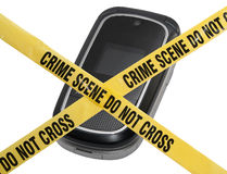 Mobile Crime Scene. A mobile cell phone is blocked by yellow police tape reading Crime Scene Do Not Cross. The concept represents compromised technology Stock Photography