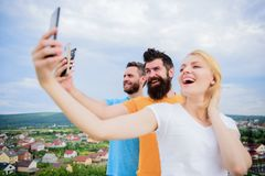Mobile dependency problem. Girl and man with mobile smartphones communication online. Selfie time. Life online. People. Mobile dependency problem. Girl and men royalty free stock images