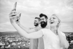 Mobile dependency problem. Girl and man with mobile smartphones communication online. Selfie time. Life online. People. Mobile dependency problem. Girl and men stock images