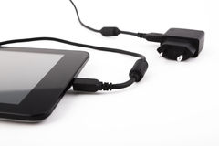 Mobile device and charger Royalty Free Stock Photo