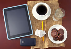 Mobile devices on the desk. Top view of mobile devices and coffee cup on the desk Royalty Free Stock Photography