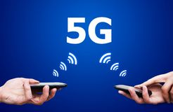 Mobile devices with 5G network communication Royalty Free Stock Photos