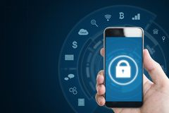 Mobile device security system. Hand holding mobile smart phone with lock and application icons. on blue background with copy space. Mobile devices security Stock Photography