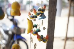 Mobile doll. A decoration made of small objects tied to wires or string and hung up so that the objects move when air blows  around them Stock Photos