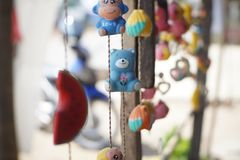 Mobile doll Teddy Bear. A decoration made of small objects tied to wires or string and hung up so that the objects move when air blows  around them Royalty Free Stock Photo