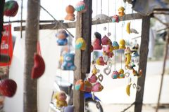 Mobile dolls. A decoration made of small objects tied to wires or string and hung up so that the objects move when air blows  around them Stock Images