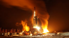 Mobile drilling rig. Night, full moon Torch royalty free stock images