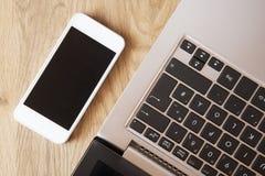 Mobile e computer portatile Fotografia Stock