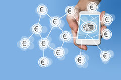 Mobile e-payment and e-commerce concept with hand holding modern smartphone in front of neutral grey background. Mobile e-payment and e-commerce concept with Stock Photos