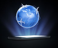 Mobile with Earth and passenger airplanes. Smartphone or a tablet device with a 3D Earth with passenger airplanes - global travel concept Royalty Free Stock Photography