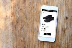 Mobile ecommerce website. With black sneaker page stock image