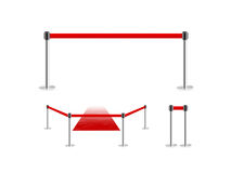 Mobile fence barrier with red belt and velvet carpet stand isolated on white. Royalty Free Stock Photography