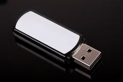 Mobile Flash Disk. On black background stock photos