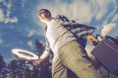 Mobile Flash Lighting Men. Mobile Flashlight Strobelight Photography Funny Concept. Young Men Enjoying Storbe Light White Caring and Using Flashlight on Himself stock image
