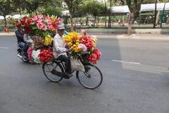 Flower seller in Vietnam. Mobile flower seller in Ho Chi Minh city in Vietnam stock images