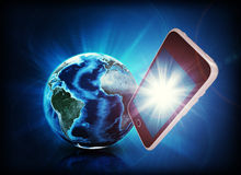 Mobile in forefround, earth on abstract background Stock Image