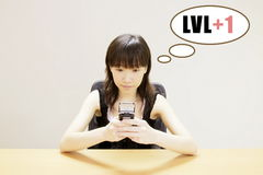 Mobile Gaming. Girl Mobile Gaming Online Competition Level Up royalty free stock photo