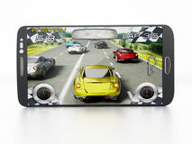 Mobile gaming. Concept with smartphone playing a racing game. My own interface design Royalty Free Stock Image