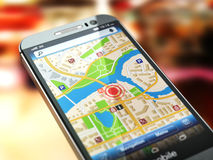 Mobile GPS navigation concept. Smartphone with city map on the s Royalty Free Stock Photo