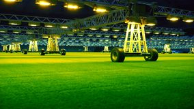 Mobile grow lighting system in sports stadium at night. stock video