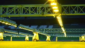 Mobile grow lighting system in sports stadium at night. Mobile grow lighting system in sports stadium at night stock video footage